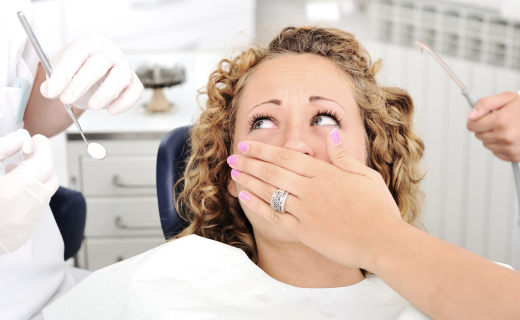 dca-blog_dental-fears-tools-scared-woman