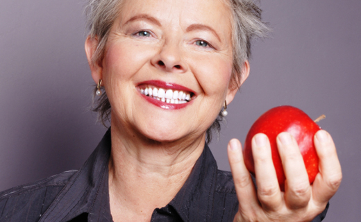 dca-blog_dentures-mature-woman-apple