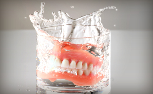dca-blog_dentures-splash-in-glass